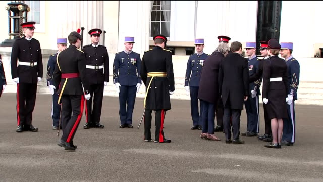 Exterior shots of Prime Minister Theresa May inspecting the guard of honour and speaking with French and British military officers with President...