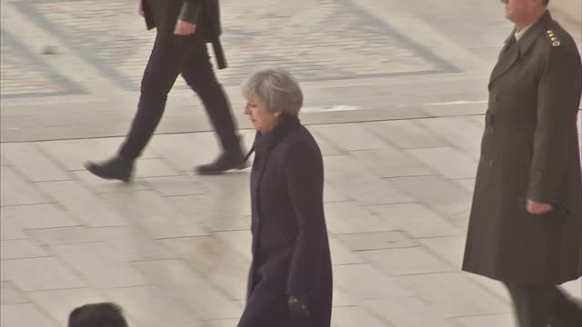 Exterior shots of Prime Minister Theresa May walking in procession with military guard who carry a large wreath towards the mausoleum of Mustafa...