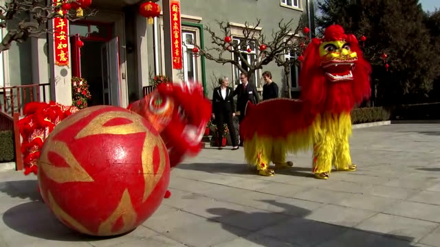 Exterior shots of Prime Minister Theresa May watching a traditional lion dancing performance outside the British Embassy and posing for a photo...