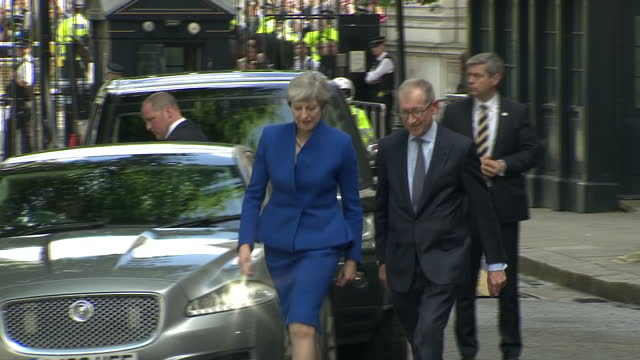 Exterior shots of Prime Minister Theresa May with husband Philip May walking along Downing Street to podium on 9 June 2017 in London United Kingdom