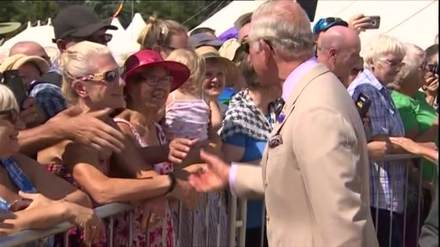 Exterior shots of Prince Charles and Camilla Duchess of Cambridge visiting the Sandringham Flower Show meeting members of the public on a sunny day...