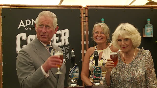 Exterior shots of Prince Charles and Camilla Duchess of Cornwall drinking a pint of Adnams beer before departing in a horse and carriage whilst...