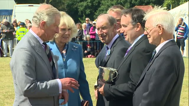 Exterior shots of Prince Charles and Camilla Duchess of Cornwall at Sandringham Flower Show Prince Charles presents cups to prizewinners and Camilla...