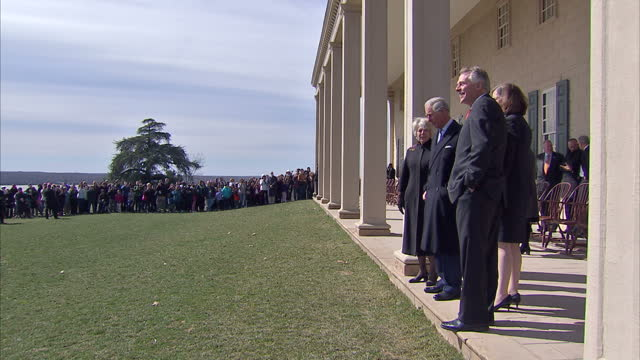 exterior shots of prince charles and camilla, duchess of cornwall viewing the east lawn with its view of the potomac river during a tour of mount... - バージニア州マウントヴァーノン点の映像素材/bロール