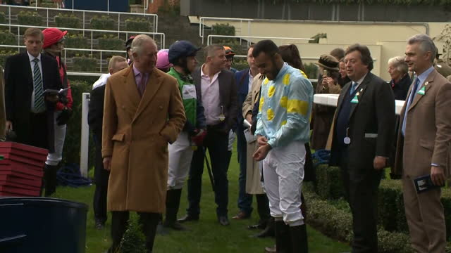 Exterior shots of Prince Charles and Camilla Duchess of Cornwall speaking to jockeys who competed in the Prince's Countryside Fund Charity Race...
