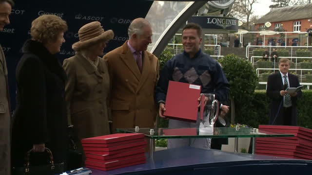 Exterior shots of Prince Charles and Camilla Duchess of Cornwall presenting prizes to jockeys who took part in the Prince's Countryside Fund Charity...