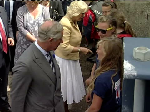 Exterior shots of Prince Charles and Camilla Duchess of Cornwall shaking hands with members of public locals and talking to them as they move along...