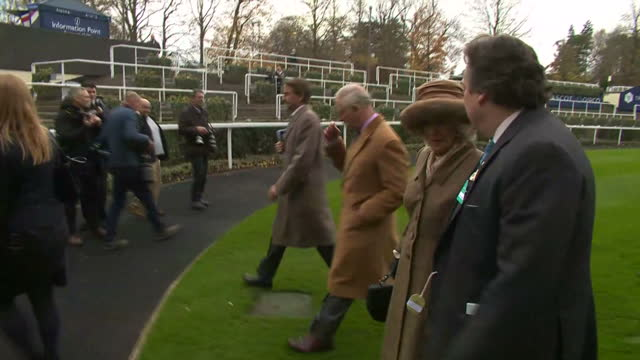 Exterior shots of Prince Charles and Camilla Duchess of Cornwall departing from the winner's enclosure after presenting prizes to jockeys who rode in...