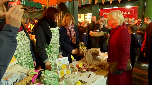 Exterior shots of Prince Charles and Camilla Duchess of Cornwall visiting Borough Market and speaking to stall holders and locals on 13th December...