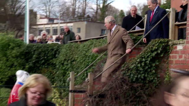 Exterior shots of Prince Charles arriving at Wallbridge Upper Lock on the Cotswold Canals and meeting volunteers and local community members involved...