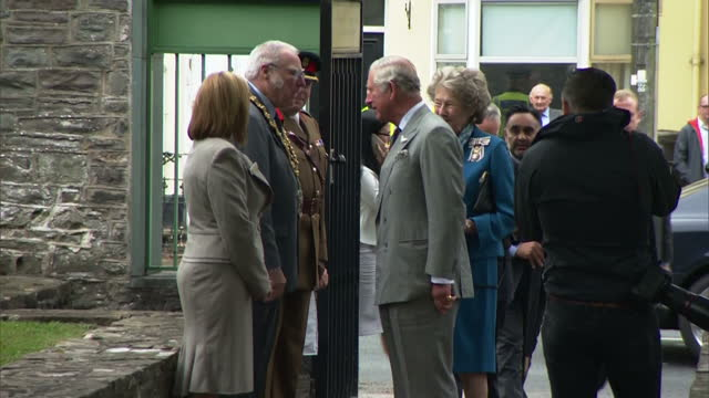 Exterior shots of Prince Charles arriving to visit the Museum of the Royal Welsh Regiment and meeting local officials