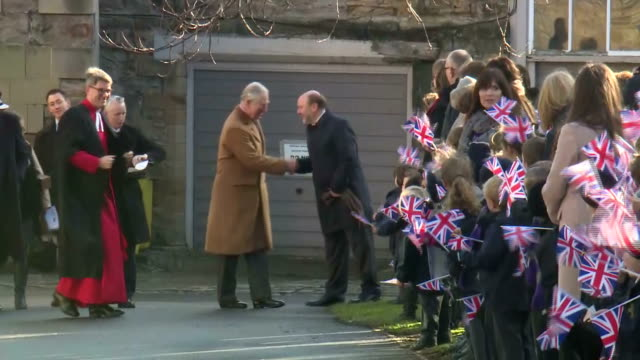 exterior shots of prince charles greeting crowds of flag waving schoolchildren outside durham cathedral>> on february 15 2018 in durham england - イングランド ダラム点の映像素材/bロール