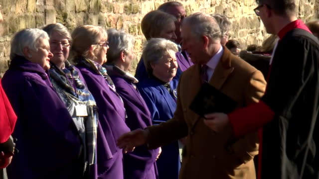exterior shots of prince charles greeting members of the public and choristers outside durham cathedral>> on february 15 2018 in durham england - イングランド ダラム点の映像素材/bロール