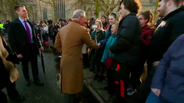 exterior shots of prince charles greeting members of the public gathered outside durham cathedral>> on february 15 2018 in durham england - イングランド ダラム点の映像素材/bロール