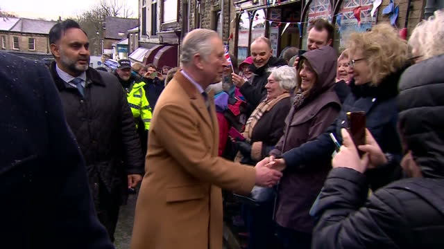 Exterior shots of Prince Charles greeting wellwishers lining the street during a visit to Clitheroe on March 21 2017 in Clitheroe England