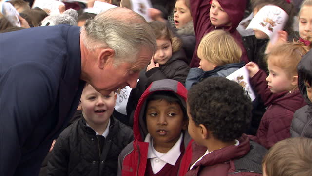 Exterior shots of prince Charles meeting local school children after a visit to the Iraqi Chaldean Christian community at the Church of the Holy...