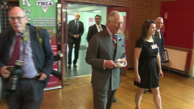 Exterior shots of Prince Charles meeting memebers of the public and drinking a cup of tea in a community centre on a visit to Londonderry after...
