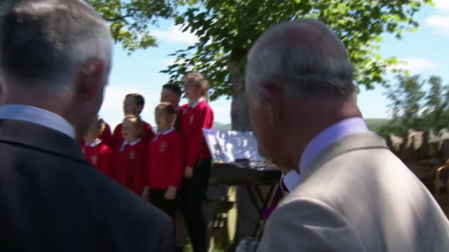 exterior shots of prince charles on a visit to trawsfynydd as school children sing a song on 5 july 2019 in trawsfynydd wales - gesellschaftsgeschichte stock-videos und b-roll-filmmaterial