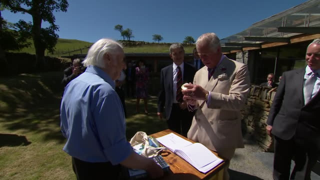 exterior shots of prince charles on a visit to trawsfynydd signing a visitors book and departing on 5 july 2019 in trawsfynydd wales - gesellschaftsgeschichte stock-videos und b-roll-filmmaterial