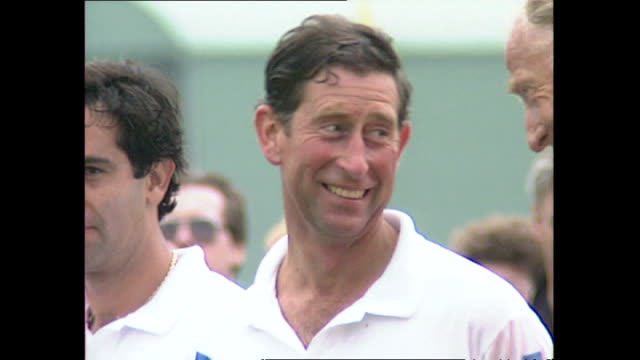 exterior shots of prince charles playing polo and receiving a trophy at the end at cowdray park on june 02, 1992 in west sussex, england. - チャールズ皇太子点の映像素材/bロール