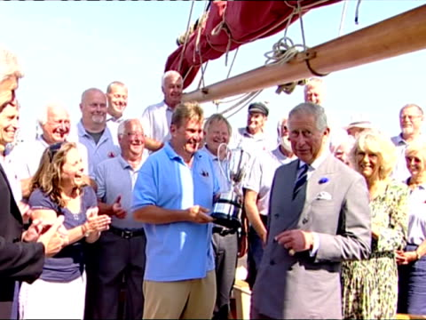 exterior shots of prince charles presenting the crew of the restored trawler, the pilgrim, with the silver george v cup. prince charles presenting... - pilgrim stock videos & royalty-free footage