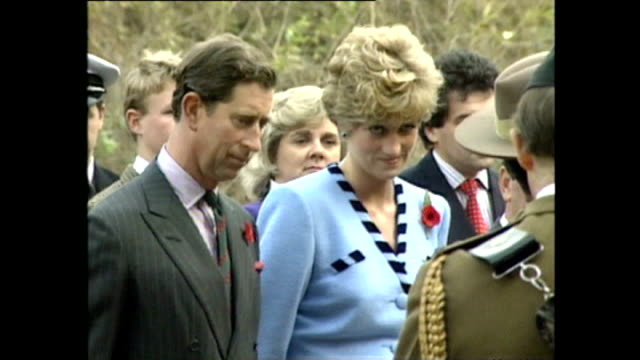 vídeos de stock, filmes e b-roll de exterior shots of prince charles prince of wales and princess diana princess of wales laying wreath at war memorial during royal tour on 6 november... - 1992