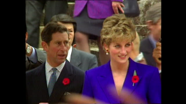 vídeos de stock e filmes b-roll de exterior shots of prince charles, prince of wales, and princess diana, princess of wales, arriving buddhist temple, during royal tour on 6 november... - 1992