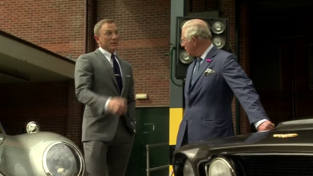 vídeos de stock, filmes e b-roll de exterior shots of prince charles prince of wales meets british actor daniel craig as he tours the set of the 25th james bond film at pinewood studios... - daniel craig ator