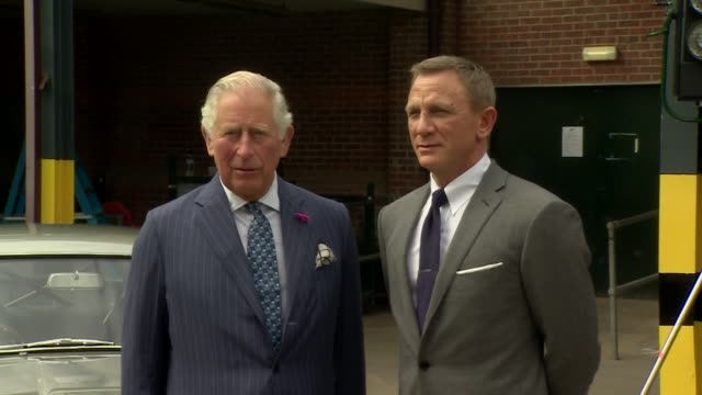 GBR: Prince Charles meets Daniel Craig, Ralph Fiennes and Naomie Harris during visit to Bond 25 set.