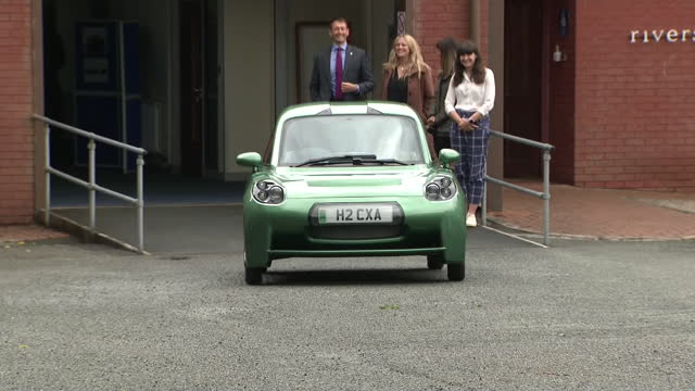 exterior shots of prince charles, prince of wales, visiting a high-tech hydrogen car company riversimple in llandrindod wells and getting in a rasa... - transportation stock videos & royalty-free footage