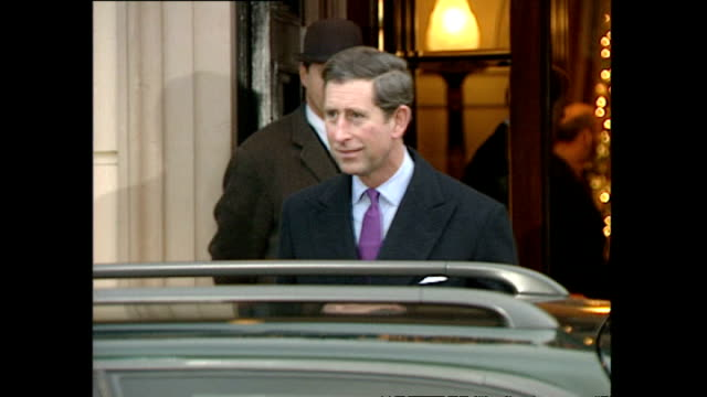 vidéos et rushes de exterior shots of prince charles stood in the doorway of the lanesborough hotel at a christmas party on 14 december 1995 in london united kingdom - paparazzi