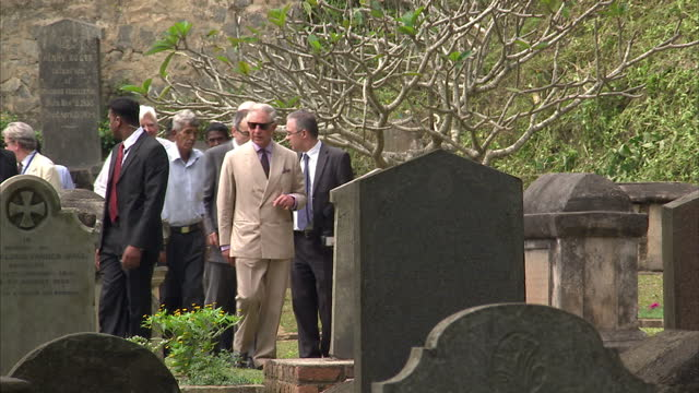 stockvideo's en b-roll-footage met exterior shots of prince charles visiting the british cantonment cemetary in kandy prince charles and duchess of cornwall tour sri lanka on november... - sri lankaanse cultuur