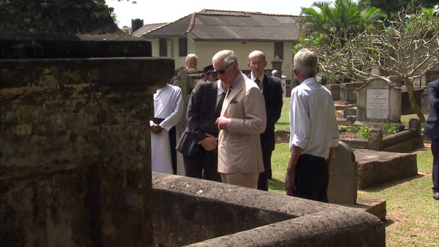 stockvideo's en b-roll-footage met exterior shots of prince charles visiting the british cantonment cemetery in kandy prince charles and duchess of cornwall tour sri lanka on november... - sri lankaanse cultuur