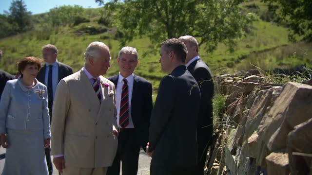 exterior shots of prince charles walking on a tour of trawsfynydd on 5 july 2019 in trawsfynydd wales - gesellschaftsgeschichte stock-videos und b-roll-filmmaterial