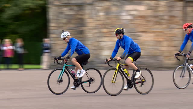 Exterior shots of Prince Edward Earl of Wessex kiss Sophie Countess of Wessex and shots of her setting off on her bicycle ride from Edinburgh to...