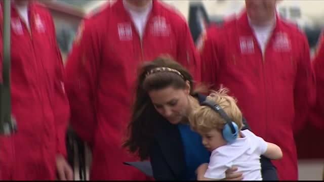 exterior shots of prince george of cambridge getting out of red arrow plane and run to mum catherine duchess of cambridge and then back to prince... - raf fairford stock videos and b-roll footage