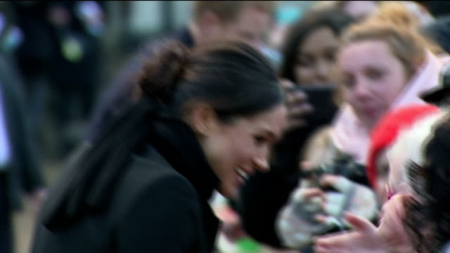 Exterior shots of Prince Harry and his fiancee Meghan Markle greeting members of the public outside Cardiff Castle>> on January 18 2018 in Cardiff...
