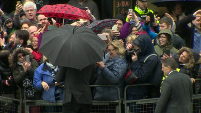exterior shots of prince harry and his fiancee meghan markle greeting cheering crowds in the centre of belfast in the pouring rain on 23 march 2018... - belfast stock videos & royalty-free footage