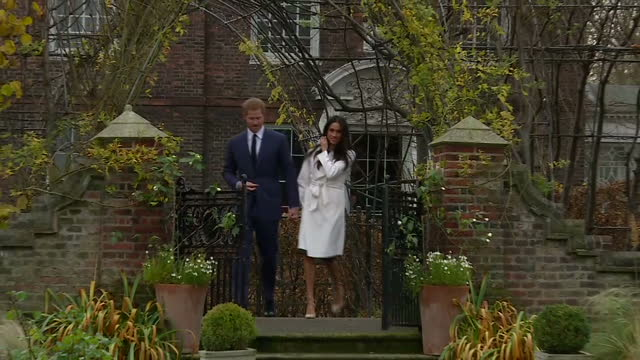 exterior shots of prince harry and his fiancee meghan markle walking through the grounds of kensignton palace before a photocall for waiting members... - fototermin stock-videos und b-roll-filmmaterial