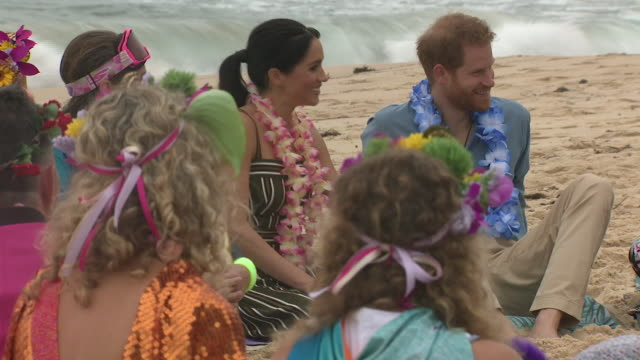 Exterior shots of Prince Harry and Meghan Duchess of Sussex joining surfing group OneWave in a circle discussion about mental health issues and...