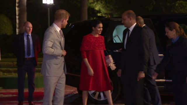 exterior shots of prince harry and meghan duchess of sussex on arrival in casablanca walking along red carpet to military honours on 24 february 2019... - casablanca morocco stock videos & royalty-free footage