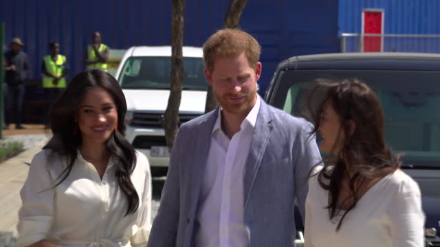 exterior shots of prince harry and meghan duchess of sussex walking from range rover into the offices of yes youth employment service on 2 october... - meghan duchess of sussex stock videos & royalty-free footage