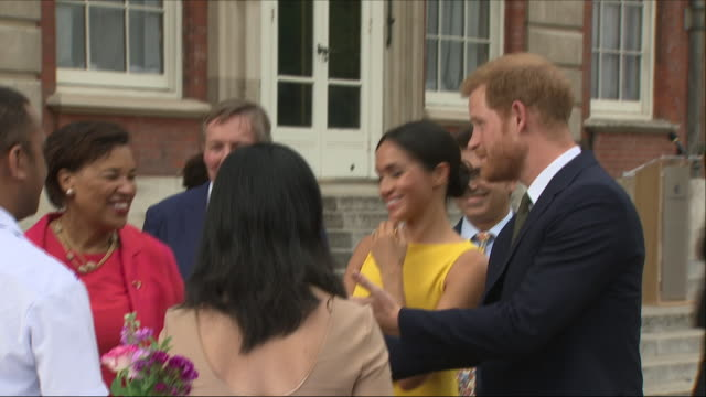 exterior shots of prince harry and meghan duchess of sussex with baroness scotland meeting various commonwealth youth leaders at an event at... - british empire stock videos & royalty-free footage