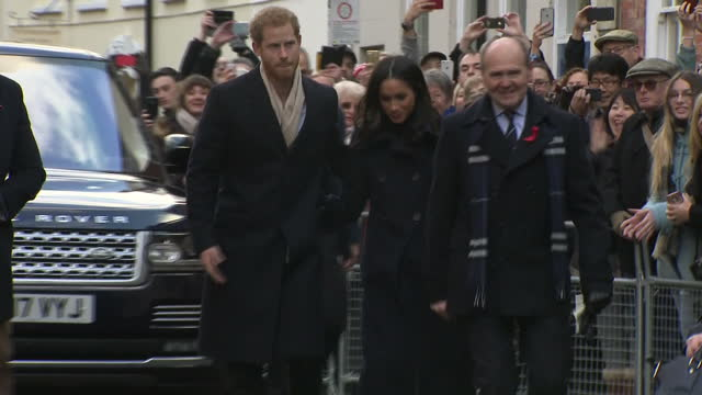 exterior shots of prince harry and meghan markle arriving in nottingham and greeting local officials as crowds look on on december 01 2017 in... - greeting stock videos & royalty-free footage