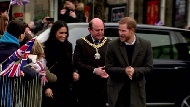 Exterior shots of Prince Harry and Meghan Markle arriving on the Espalande outside Edinburgh Castle and greeting officials and members of the...