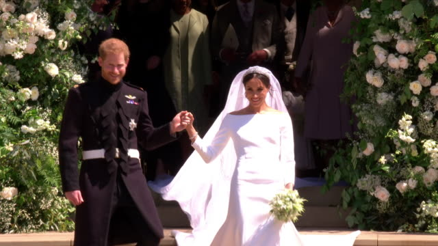 exterior shots of prince harry and meghan markle departing st george's chapel followed by members of the royal family including prince charles... - hochzeit stock-videos und b-roll-filmmaterial