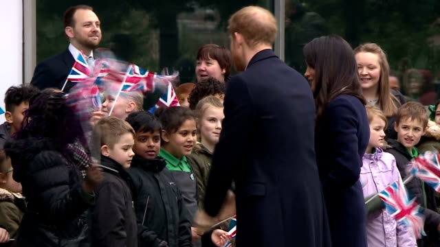 Exterior shots of Prince Harry and Meghan Markle greeting schoolchildren and officials outside Millennium Point in Birmingham before attending an...