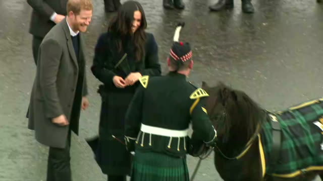 Exterior shots of Prince Harry and Meghan Markle greeting crowds outside Edinburgh Castle before meeting Cruachan VI the Shetland pony Regimental...