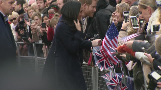 Exterior shots of Prince Harry and Meghan Markle greeting members of the public lininig the streets in Nottingham many filming and taking pictures on...