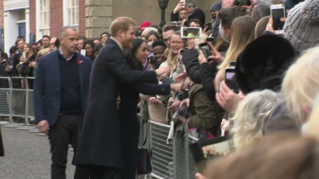 exterior shots of prince harry and meghan markle greeting members of the public lining the street in nottingham some waving union jack and united... - waving stock videos & royalty-free footage